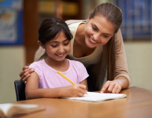 Teacher assisting students in one to one learning at Hoxton Tutoring